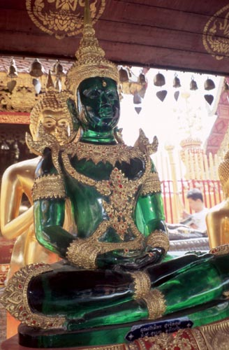 This glass Buddha is patterned after the famous Emerald Buddha, now in Bangkok.